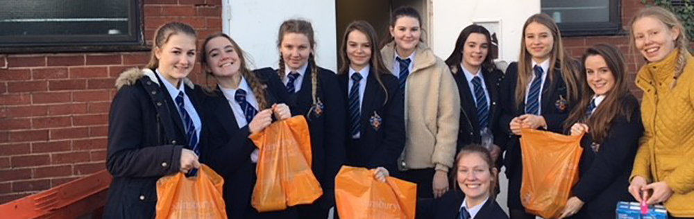 The Netball team deliver provisions to the Gloucester Food Bank